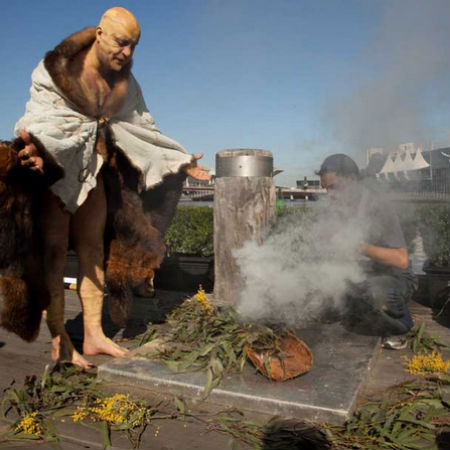 Indigenous Elder Bill Nicholson Jnr performing a smoking ceremony at the flag-raising ceremony at Enterprize Park.