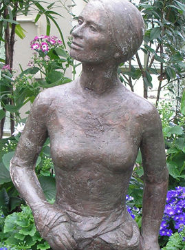 Statue of Mary Gilbert, one of the first settlers, in the Fitzroy Gardens conservatory.