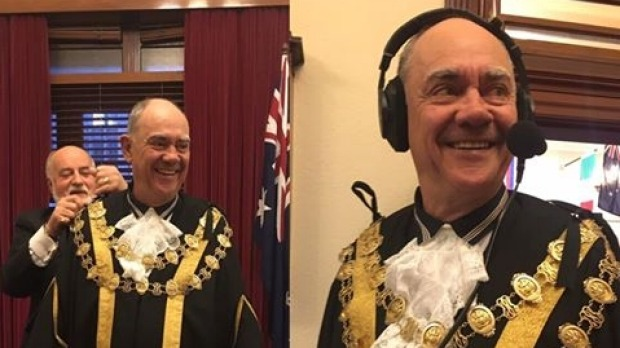 3AW's John Burns tries on the mayoral robes on Melbourne Day